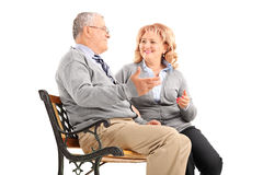 Mature couple talking to each other and smiling royalty free stock image