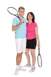 Mature couple with tennis racquets Royalty Free Stock Photography