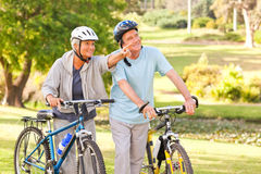 Mature couple with their bikes Stock Photo