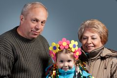 А mature couple with their granddaughter Royalty Free Stock Photos
