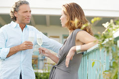 Mature couple on vinyard balcony. Royalty Free Stock Photo