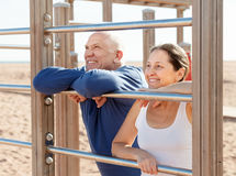 Mature couple together near sports equipment stock photography