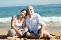 Mature couple together at sea beach Stock Images
