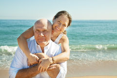 Mature couple together at sea beach Stock Photography