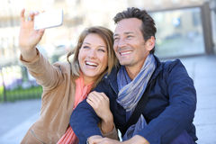 Mature couple in town taking selfie Stock Images