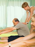 Mature couple with trainer at gym Royalty Free Stock Photo