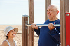 Mature couple training with chin-up bar Royalty Free Stock Image