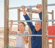Mature couple training with chin-up bar  in summer Stock Photo