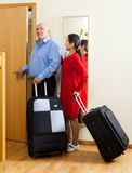 Mature couple of travelers with suitcases in home Royalty Free Stock Photo