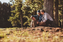 Mature couple using a compass on a hike Stock Photography