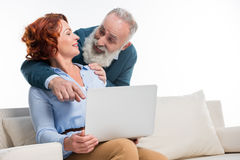 Mature couple using laptop Royalty Free Stock Photography
