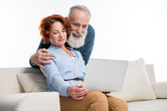 Mature couple using laptop Stock Image