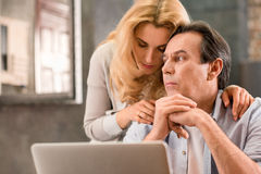 Mature couple using laptop together at home Royalty Free Stock Photo