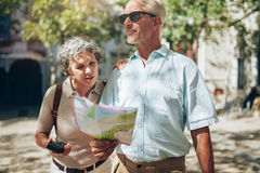 Mature couple using a map on a vacation Stock Photography