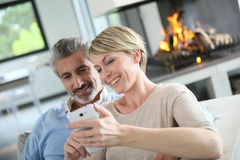 Mature couple using smartphone Stock Photography