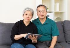 Mature couple using tablet computer Stock Photos