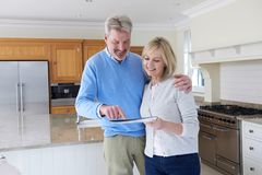 Mature Couple Viewing New Home Standing In Kitchen Looking At Br stock photos