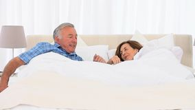 Mature couple waking up Royalty Free Stock Photography