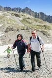 The mature couple walk in Alps Royalty Free Stock Photos