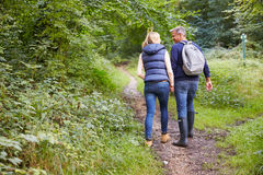 Mature Couple On Walk Through Beautiful Countryside Stock Images