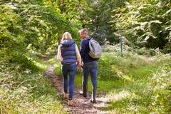 Mature Couple On Walk Through Beautiful Countryside Stock Photography