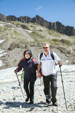 The mature couple walk in mountains Royalty Free Stock Image
