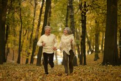 Mature couple walking Stock Photos