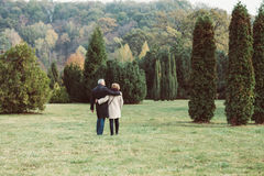 Mature couple walking in autumn park Royalty Free Stock Photos