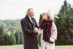 Mature couple walking in autumn park Royalty Free Stock Photo