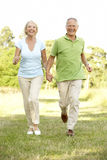 Mature couple walking in countryside Royalty Free Stock Photography