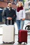 Mature couple walking with luggage Stock Images