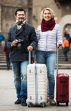 Mature couple walking with luggage Royalty Free Stock Image