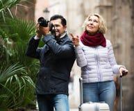 Mature couple walking with luggage Stock Photo