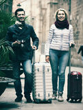 Mature couple walking with luggage Stock Photo