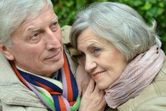 Mature couple walking in the park Stock Photos