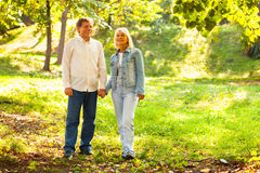 Mature couple walking in the park Royalty Free Stock Image