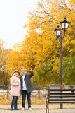 Mature couple walking in park royalty free stock photography