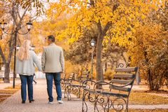 Mature couple walking in park stock photo
