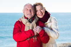 Mature couple walking by sea Stock Photo