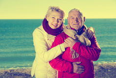 Mature couple walking by sea Stock Photos