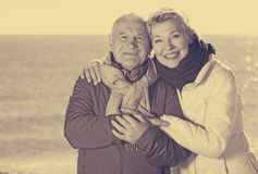 Mature couple walking by sea Royalty Free Stock Photography