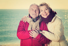 Mature couple walking by sea Royalty Free Stock Photos