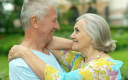 Mature couple walking in town Stock Photos