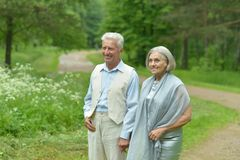 Mature couple walking in town Royalty Free Stock Photo