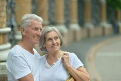 Mature couple walking in town Stock Photography