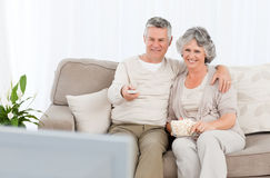 Mature couple watching tv in their living room Stock Image