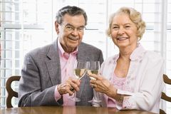 Mature couple with wine. Royalty Free Stock Image