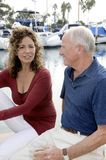 Mature Couple on Yacht. Senior couple enjoying a conversation on a yacht Royalty Free Stock Image