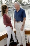 Mature Couple on Yacht. Senior couple enjoying a conversation on a yacht Stock Images