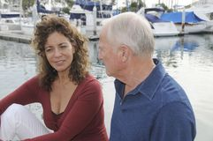 Mature Couple on Yacht. Senior couple enjoying a conversation on a yacht Royalty Free Stock Images